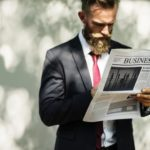 Man-In Business Suit And Tie-Reading News Paper-Business Man