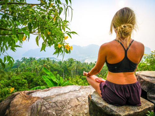 woman-meditating-health-fitness-mountain view