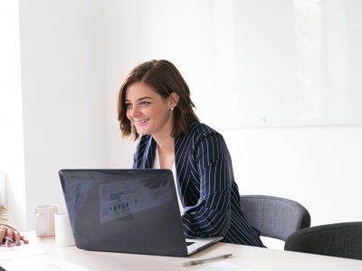 woman-smiling-personal-growth-at colleague